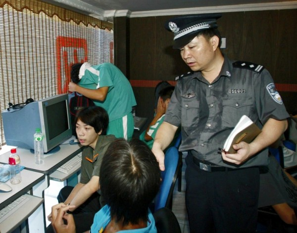 internet police in china File photo of a man using a computer in an internet cafe in beijing, june 1, 2017 amid a tightening of internet controls in china, police in the eastern chinese province of shandong are forcing local cafes and restaurants offering public wifi to install police-approved routers to connect to the internet.