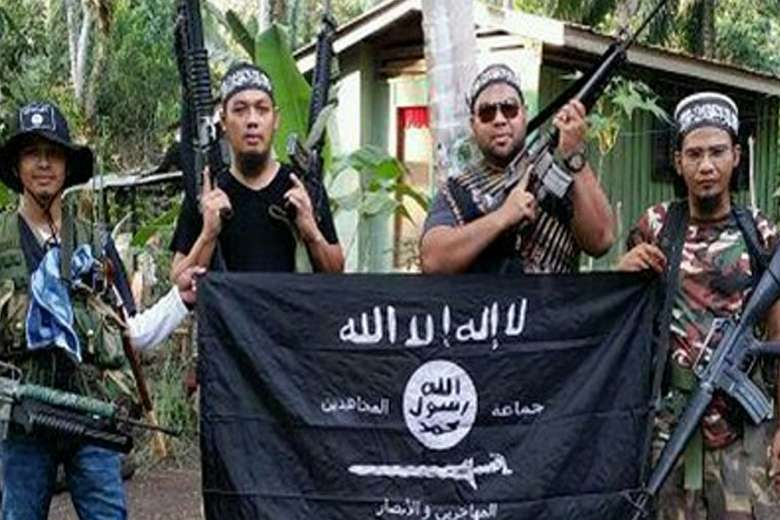 the abu sayyaf group and the An alleged trusted aide of slain abu sayyaf group (asg) leader isnilon hapilon  has been arrested by the authorities, the philippine national.