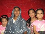 BANGLADESH_(F)_0911_-_The_persecuted_Ms._Khainur_Islam_with_her_daughter_Arifa_sultana_and_two_sall_daughter_(600_x_450).jpg