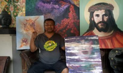 IND-_Painting_artist_Ismanto_from_Magelang_makes_a_barter_deal_his_painting_with_amenities.jpeg