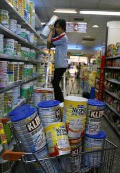 CHINA Milk crisis to cost billions putting millions of job